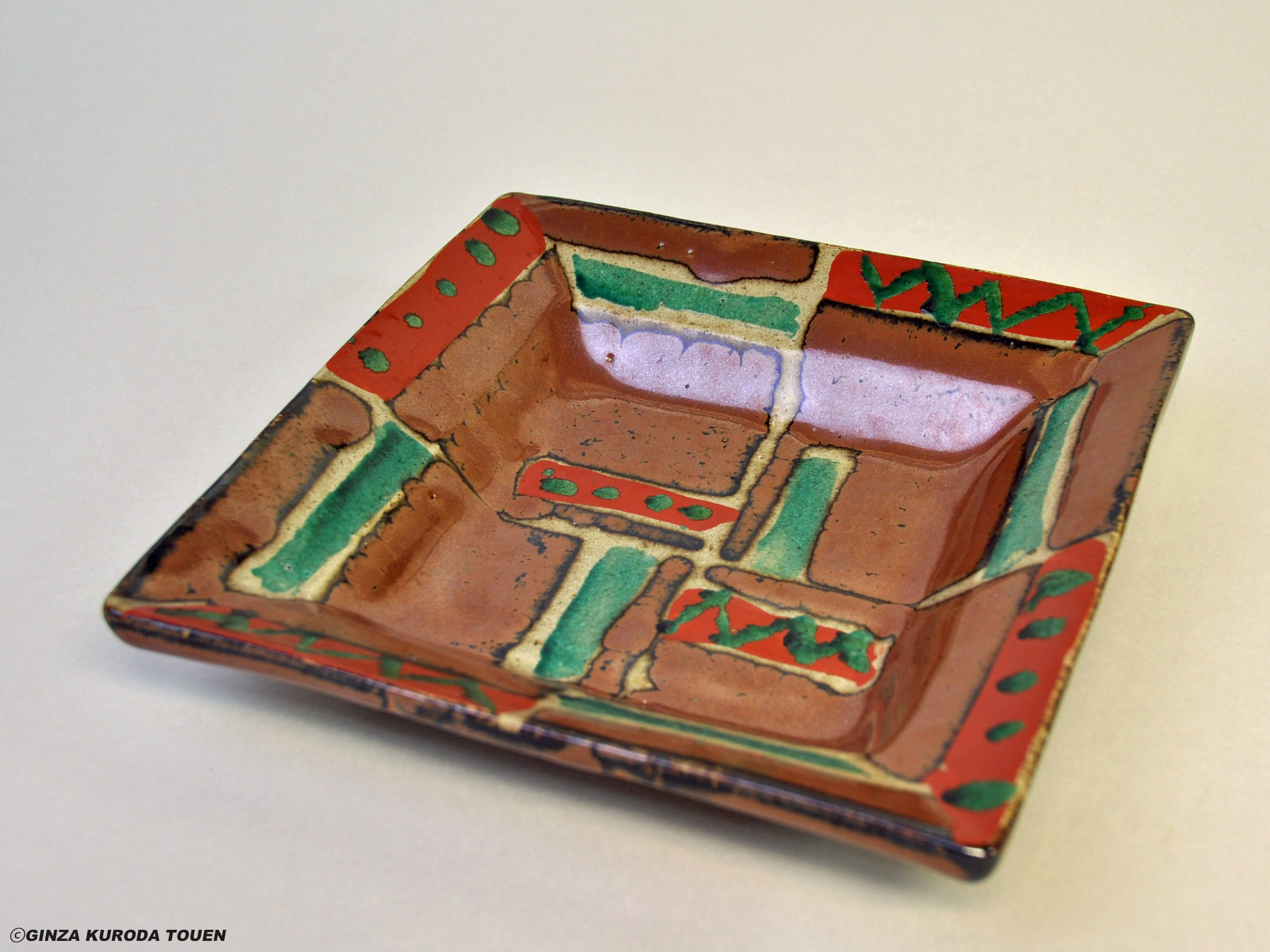 Shoji Hamada: Square plate, Kaki glaze with red and green painting